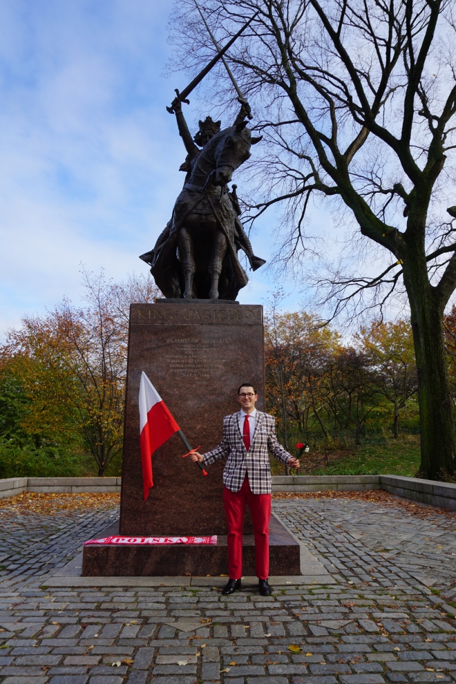 image of patriotic polish man in front of sculpture